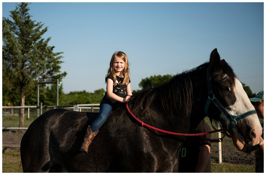 Kylie with horses at Lakeland RV Ranch
